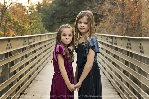 Two Girls Posing For Photo On Bridge