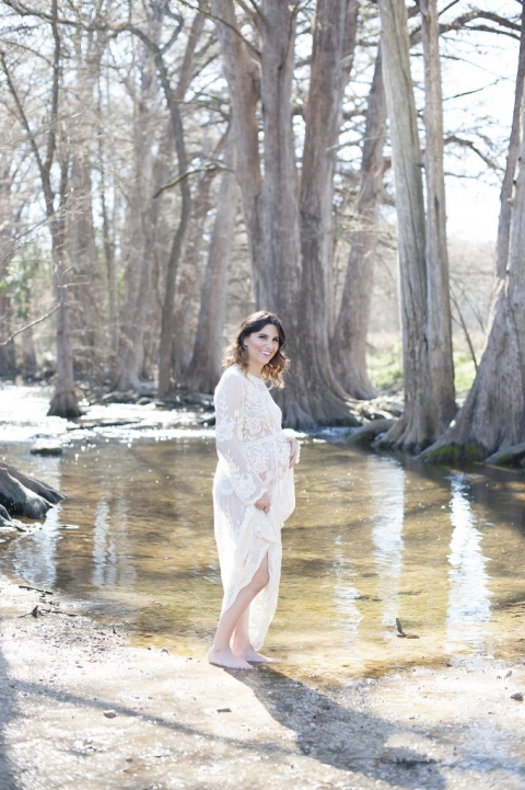 beautiful pregnant mom posing in water for photos
