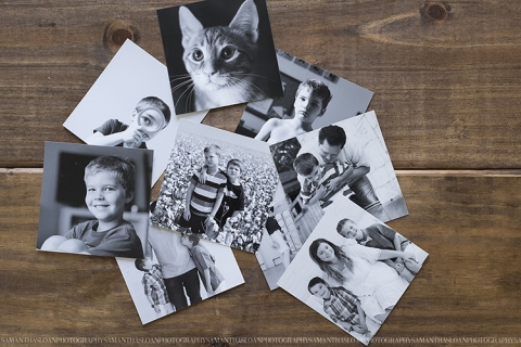 printed black and white photos laying on desk