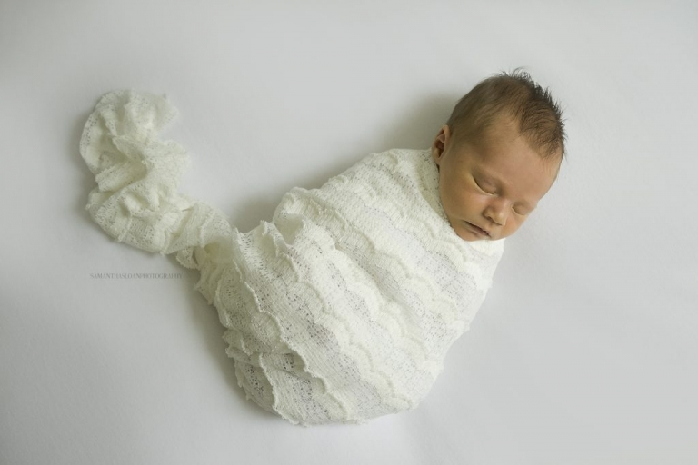 newborn baby girl swaddled for photo session