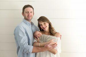 Mom And Dad Holding Newborn Baby Boy