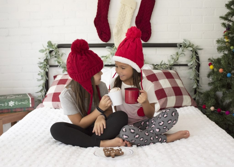 Girls Laughing On Bed For Christmas Photos in San Antonio Texas