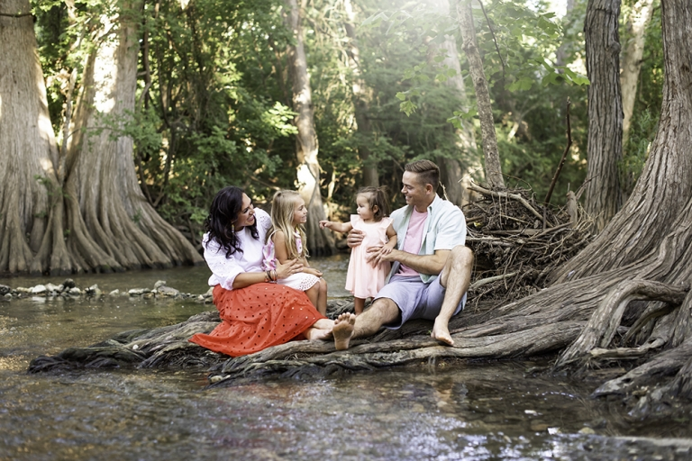 River Mini Sessions With Family Posing On River At Cibolo Nature Center