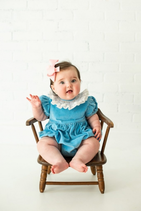 Baby Girl Posing For Milestone Pictures In San Antonio Studio