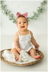 Cute Baby Girl Smiling For Pictures In San Antonio Photo Studio